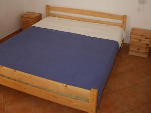 A bed or beds in a room at Mare Nostrum Apartments