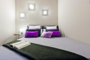 A bed or beds in a room at Ronda Sant Pere with Terrace