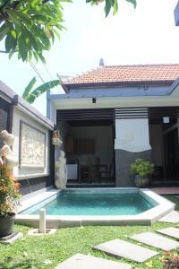 Piscine de l'établissement Alit Bali Villa ou située à proximité