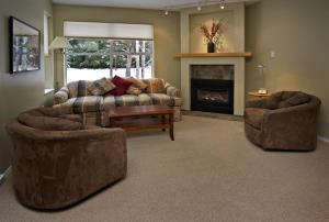 A seating area at Wildwood Lodge by Westwind Properties