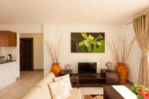A seating area at Praslin Holiday Home