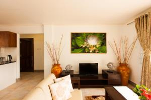 The lounge or bar area at Praslin Holiday Home