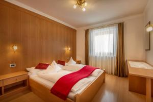 A bed or beds in a room at Residence Angelika