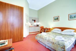 Cama o camas de una habitación en Krakow City Apartments