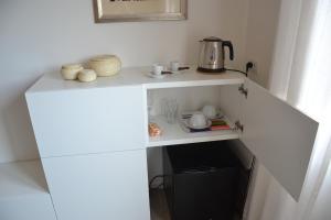 A kitchen or kitchenette at Studio Cardello Colosseum