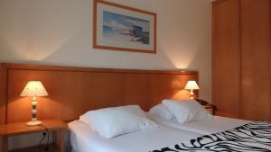 Uma cama ou camas num quarto em Jardins da Ria