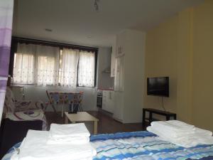 A bed or beds in a room at Apartamento Cuatro Torres