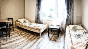 Łóżko lub łóżka w pokoju w obiekcie Villa 106