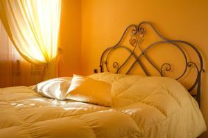 Gulta vai gultas numurā naktsmītnē Villa Degli Ulivi