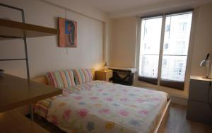 A bed or beds in a room at Apartment Invalides