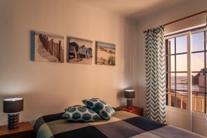 Un ou plusieurs lits dans un hébergement de l'établissement Casas do Zé