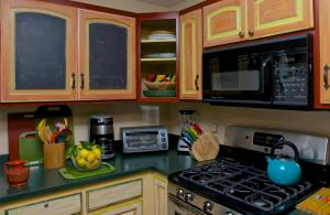 A kitchen or kitchenette at Two Room Inn