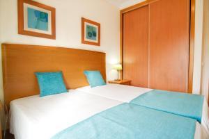 Postelja oz. postelje v sobi nastanitve Flamingo Apartments