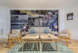 A seating area at Slow Suites Luchana
