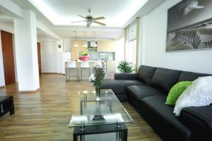 A seating area at Achillion Apartments