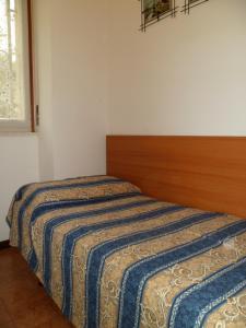 Postel nebo postele na pokoji v ubytování Villa GENNY