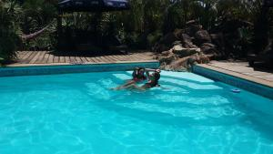 The swimming pool at or near Aloe Village Apart Hotel
