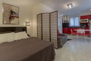 Krevet ili kreveti u jedinici u objektu Hotel De L'Horloge