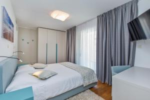 Cama o camas de una habitación en Dubrovnik Luxury Residence – L'Orangerie