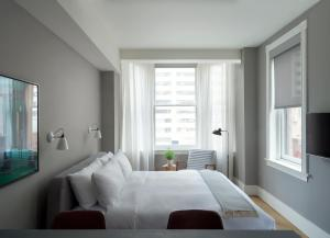 A bed or beds in a room at ROOST Rittenhouse