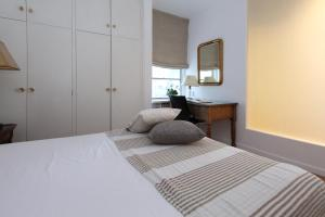 A bed or beds in a room at Apartamento Tosca Deco