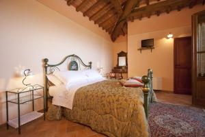 A bed or beds in a room at Corte Delle Stelle