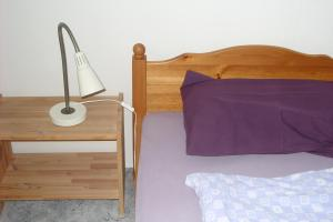 A bed or beds in a room at Masi Apartman