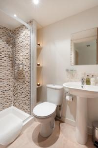 A bathroom at Henderson Street Apartment