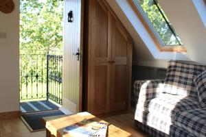 A bed or beds in a room at Oakwrights