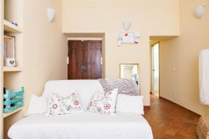 A bed or beds in a room at Trastevere Apartment