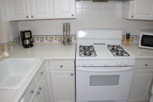 A kitchen or kitchenette at Ocean Vacation Homes