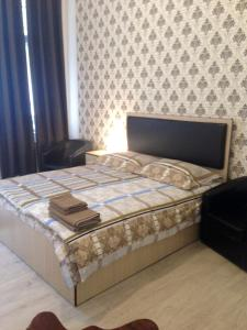 A bed or beds in a room at White Central Apartment