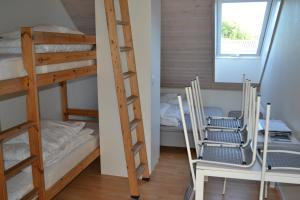 A bunk bed or bunk beds in a room at Nørager Apartments