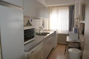 A kitchen or kitchenette at Family Apartment Knokke
