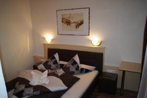 Cama o camas de una habitación en Ferienhaus Alpenroyal