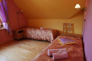 A bed or beds in a room at Brīvdienu Māja Riekstnieki