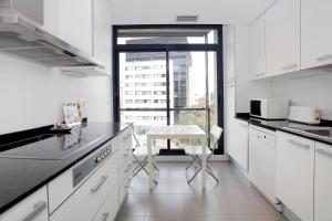 A kitchen or kitchenette at Apartment Olympic Village