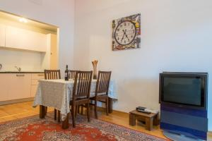 A television and/or entertainment center at Parkers Boutique Apartments - Old Town Square