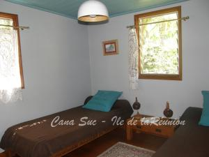 A bed or beds in a room at Cana Suc