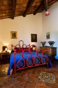 Ein Bett oder Betten in einem Zimmer der Unterkunft Agriturismo Pomantello