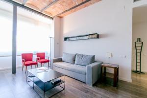 Area soggiorno di Decô Apartments Barcelona-Diagonal