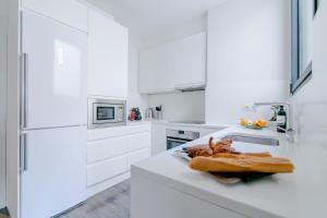 Majoituspaikan Decô Apartments Barcelona-Diagonal keittiö tai keittotila