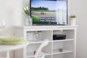 A television and/or entertainment centre at Life Inn Apartment