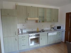 Küche/Küchenzeile in der Unterkunft Ferienwohnung Helena
