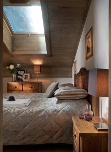 Un ou plusieurs lits dans un hébergement de l'établissement CGH Résidences & Spas Le Télémark