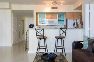 A kitchen or kitchenette at Apartment By Great Sunny Isles Lodging