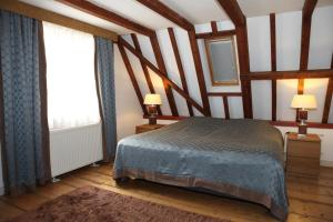 A bed or beds in a room at Hendrick de Keyser Apartment