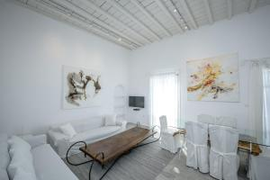A bed or beds in a room at Mykonos Art Villa