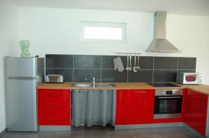 Cuisine ou kitchenette dans l'établissement Gîte Les Sources de l'Andelle