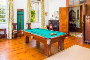 A pool table at Liiiving in Ofir | Manor Pool House